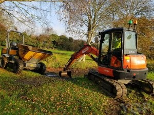 image of a digger building a pond